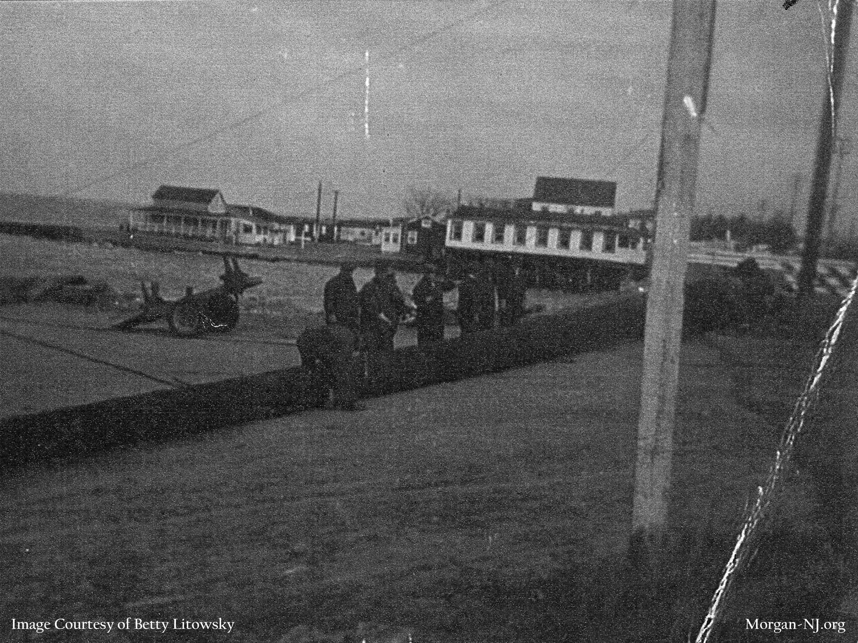 """Looking across Cheesequake Creek Channel toward Morgan Beach from Robert E. Lee Inn in the 1940's sometime after 1943 during a very high tide. """"Hock's Pavilion"""" / Blodgetts Rooming House on the left, Morgan Beach bungalows in the center, and Kaiser's Tavern on the right. Image courtesy of Betty Macrae Litowsky."""