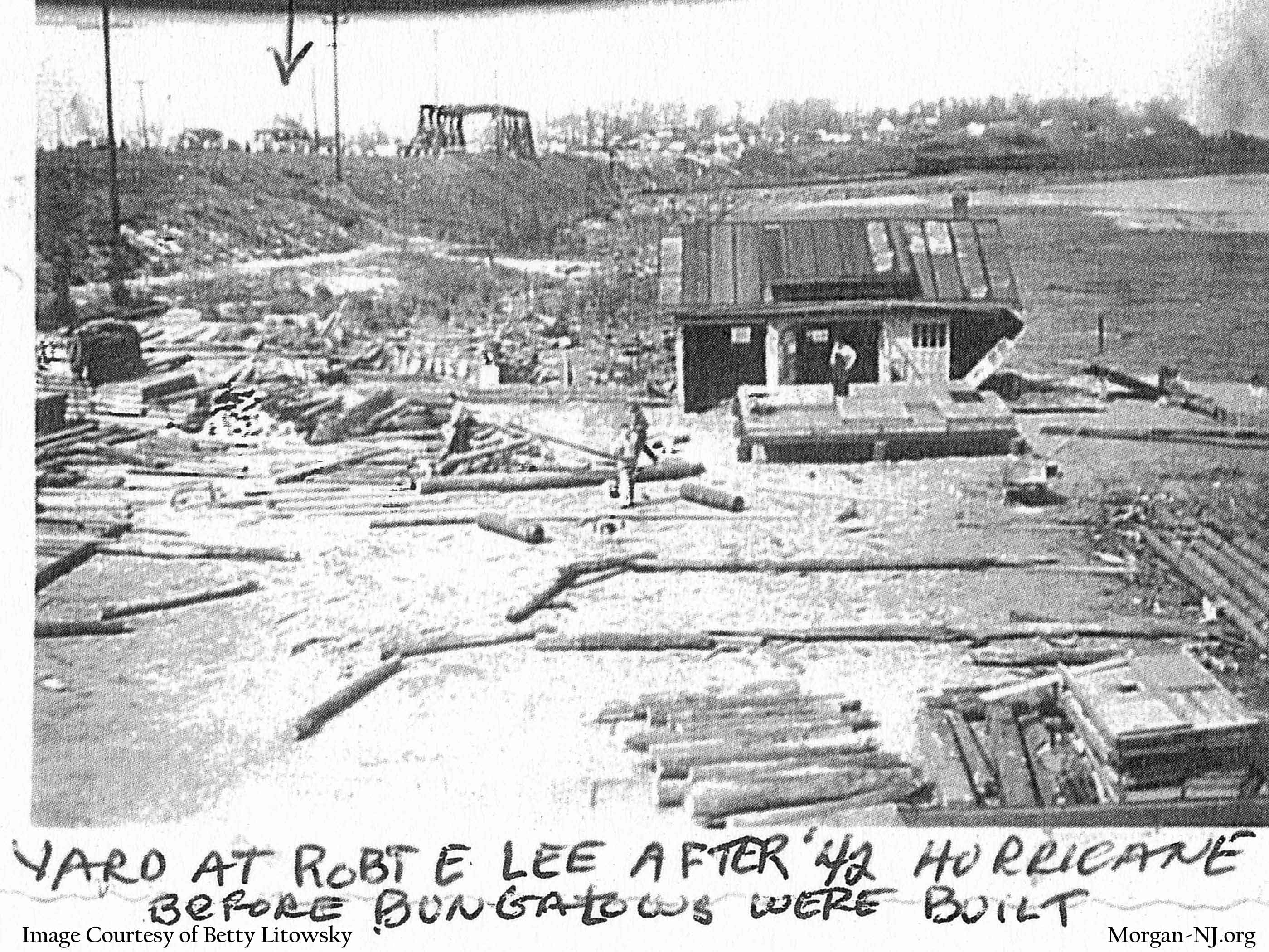 """Looking Northwest from Robert E. Lee Inn toward the yard after the 1942 hurricane (this was before hurricanes were given yearly sequential alphabetical names). Notice the steam train in the background below """"Morgan Heights"""". Image courtesy of Betty Macrae Litowsky."""