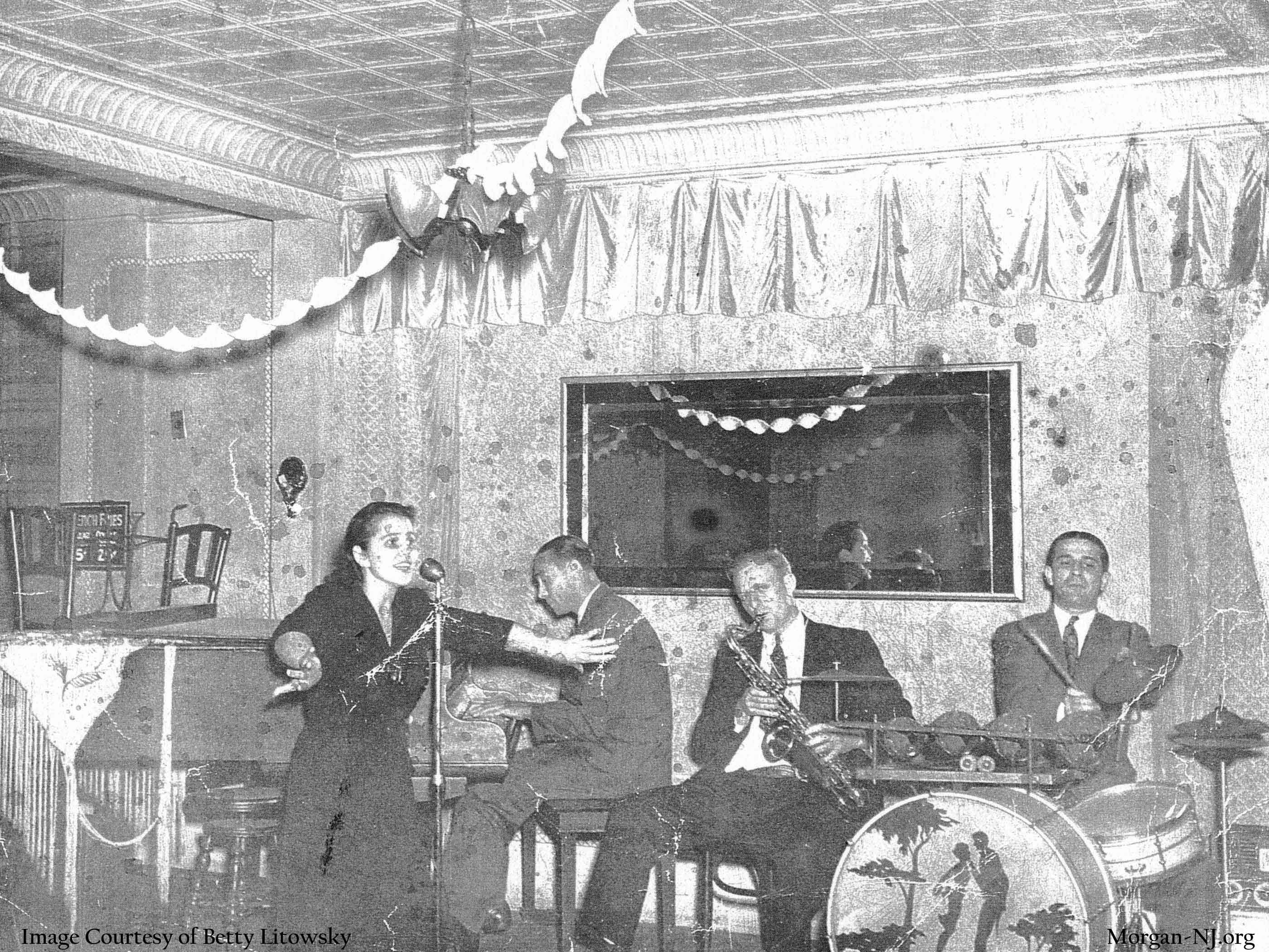 War time entertainment by Ruth Macrae singing with Billy Coleman on piano, Mike O' Brien on saxophone, and Eddie Coleman on drums, 1943. Image courtesy of Betty Macrae Litowsky.